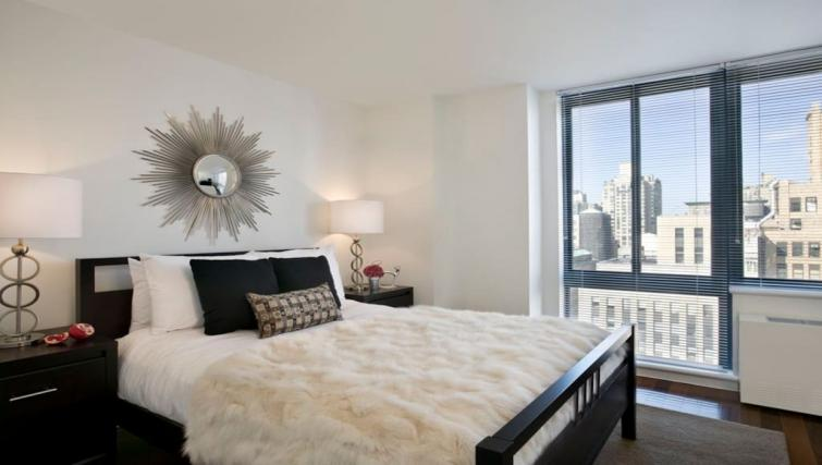 Bright bedroom at Instrata Gramercy Apartments
